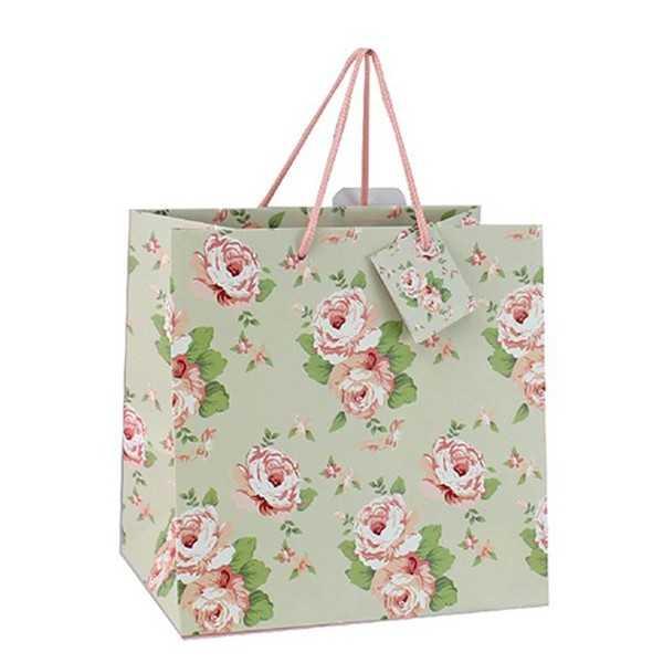 Gavepose i lysegrønt papir med roser