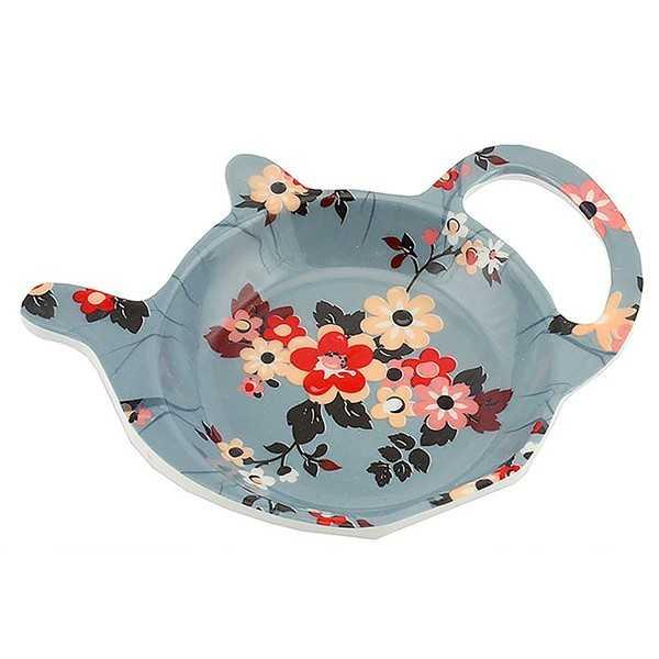 Teposeholder til den brugte tepose med blomstermotiv